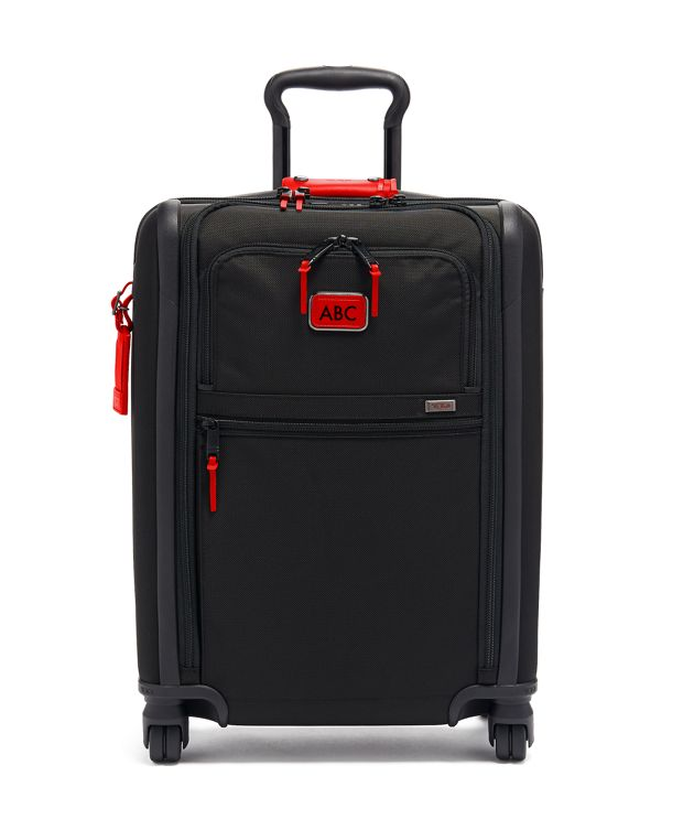 International Slim 4 Wheeled Carry-On in Cherry